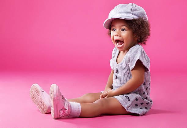 Stylish little girl playing up stock photo
