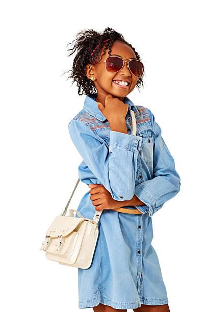 stylish little girl posing with sunglasses and purse - kinderhandtaschen stock-fotos und bilder