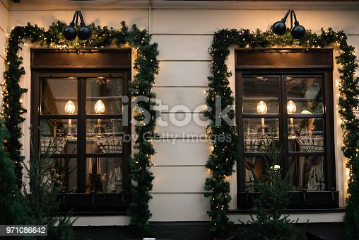 istock stylish luxury  christmas  vintage garland on window, celebration decoration for holidays in the city 971086642
