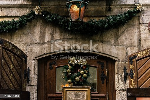istock stylish luxury christmas wreath on vintage door, celebration decoration for holidays in the city 971079054