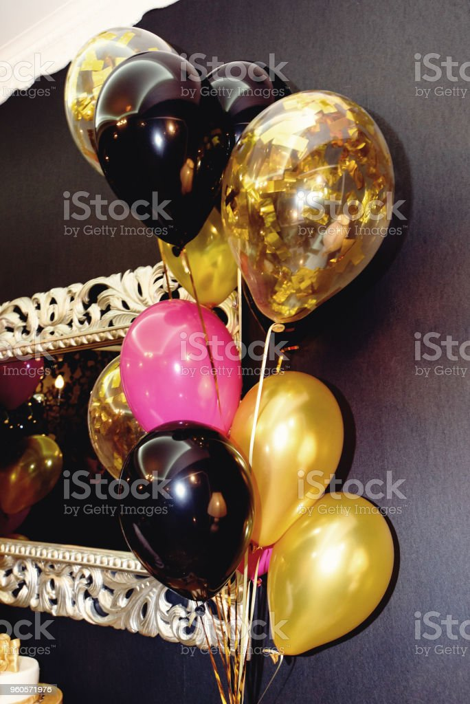 stylish luxury decorated restaurant with balloons at the golden birthday party, holiday celebration concept stock photo