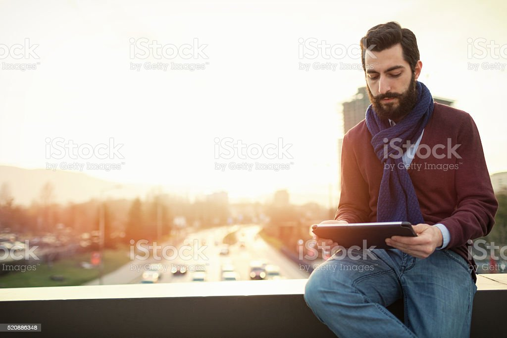 Stylish male with tablet stock photo