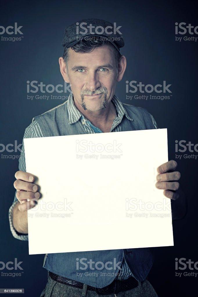 stylish man holding a white sign stock photo