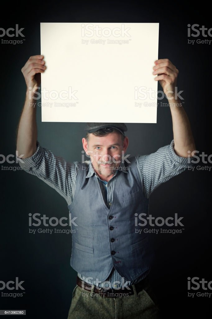 stylish man holding up a white board stock photo