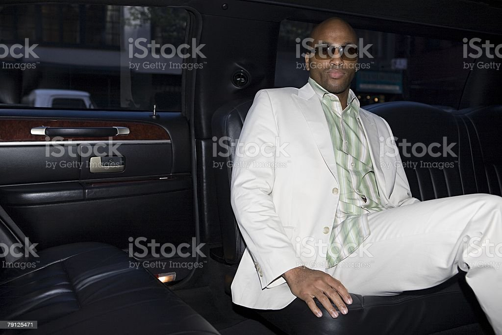 Stylish man in a limo stock photo