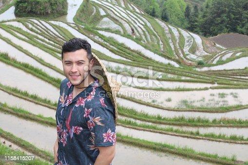 607590542istockphoto Stylish man in Asian rice terraces 1158415207