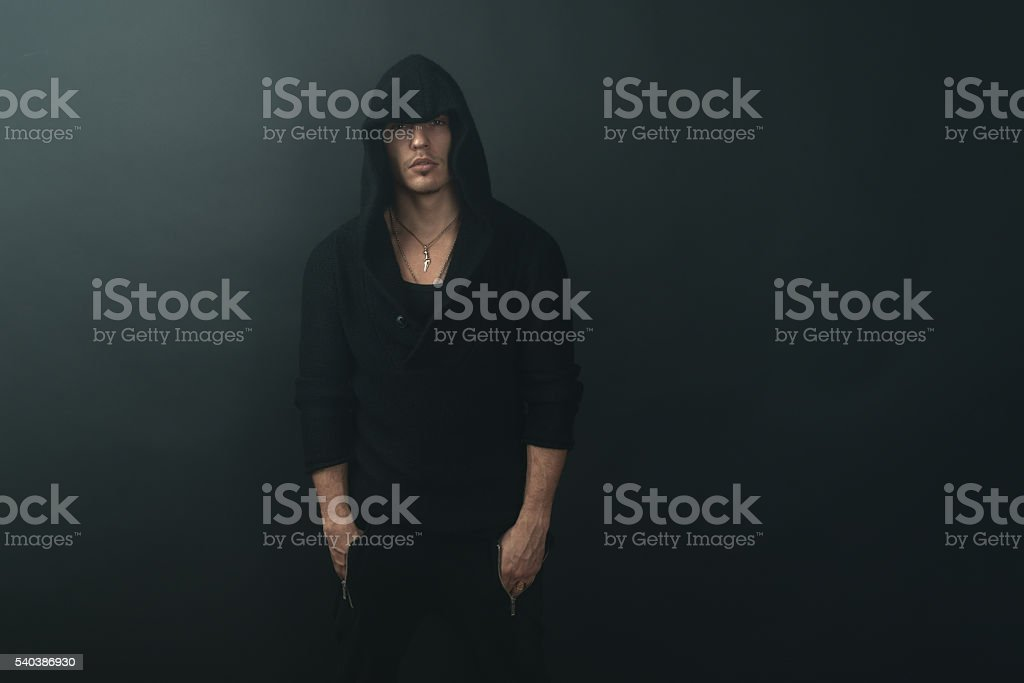 stylish man in  black hoodie stock photo