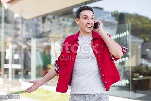istock Stylish man in denim red jacket feeling very happy 975742274