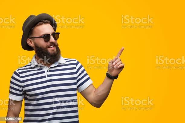 Stylish man in sunglasses pointing up picture id1133562916?b=1&k=6&m=1133562916&s=612x612&h=apex72czggyd7aw4jszltgafymynbbp2r45vc1lxuui=