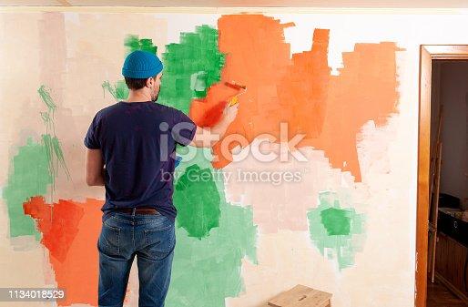 istock Stylish man making repairs in his apartment 1134018529
