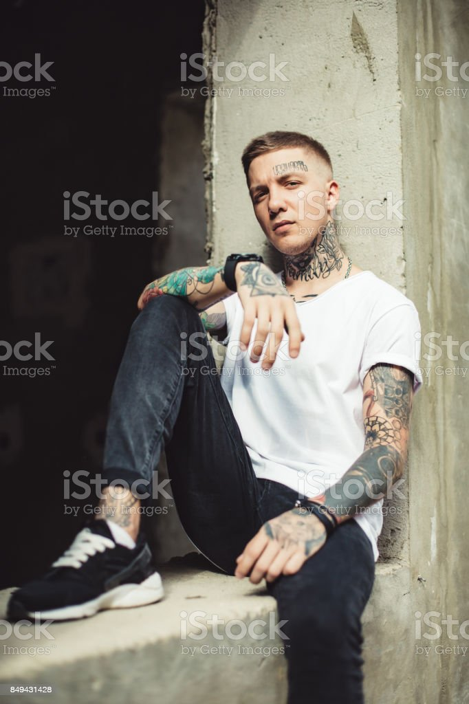 Stylish man posing outside stock photo
