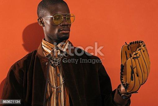 istock stylish man with baseball glove 863621134