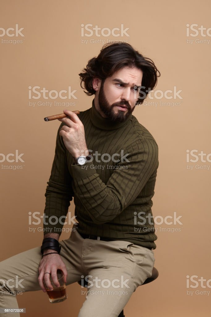 Stylish man with drink and cigar royalty-free stock photo