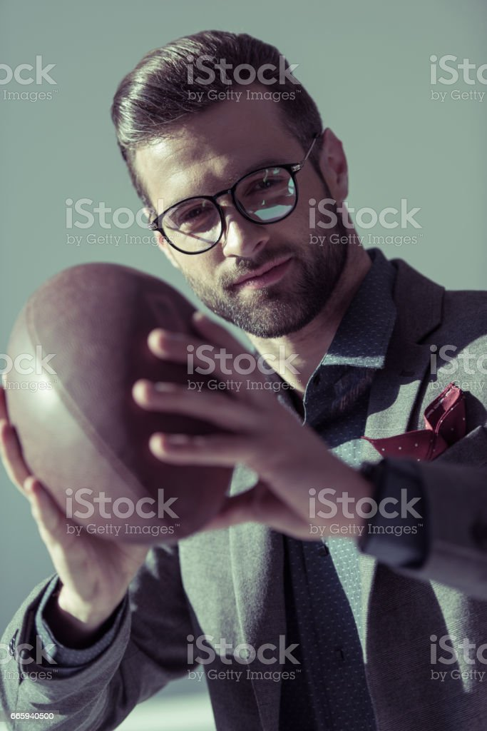 Stylish man with rugby ball foto stock royalty-free