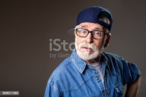 istock Stylish mature man looking stunned 906021580