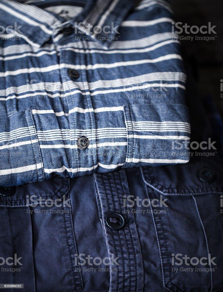 stylish men's clothing, shirts folded in a pile zbiór zdjęć royalty-free