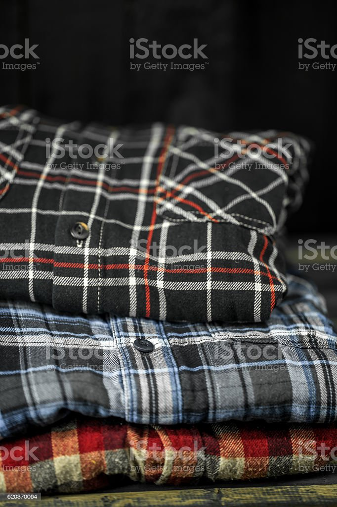 stylish men's clothing, shirts folded in a pile foto de stock royalty-free