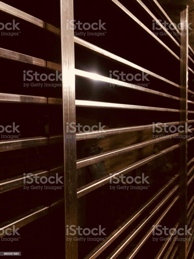 Stylish metallic shiny protection grill at night stock photo