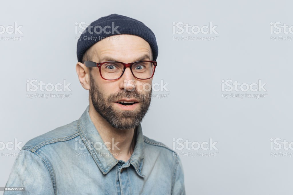 Stylish Middle Aged Male With Suprised And Curious Expression Wears