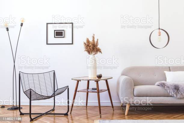 Stylish Minimalistic Living Room With Design Grey Sofa Black Armchair Geometric Lamp Retro Table And Elegant Accessories Mock Up Posters Frame On The White Walls Minimalistic Home Decor Stock Photo Download