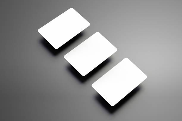 stilvolle mock-up von einem drei bank (gutscheine), die diagonal auf grauem hintergrund. - gutschein ausdrucken stock-fotos und bilder