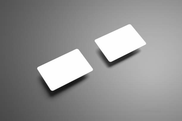 stilvolle modell für eine zwei-bank-geschenk-karten auf einem grauen hintergrund. - gutschein ausdrucken stock-fotos und bilder