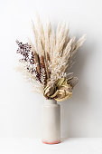Stylish modern dried flower arrangement in a cream and pink ceramic vase. Including Banksia, pampas grass, bulrush and ruscus leaves. Art deco/Boho gift for Anniversary, birthday, mothers day.