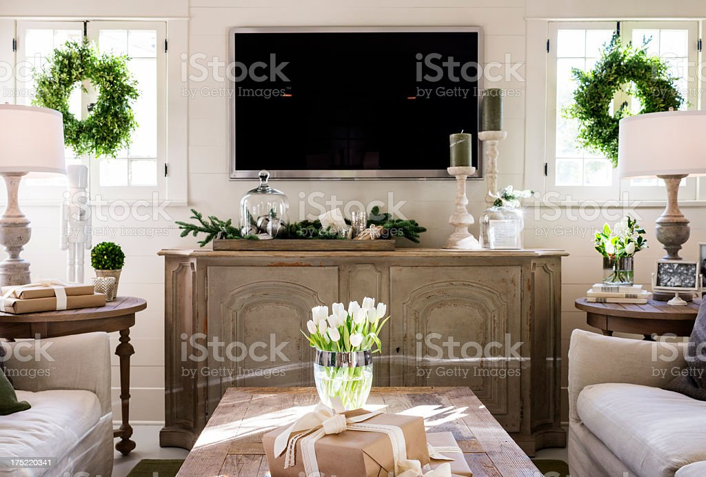 Stylish modern home interior with green accents stock photo
