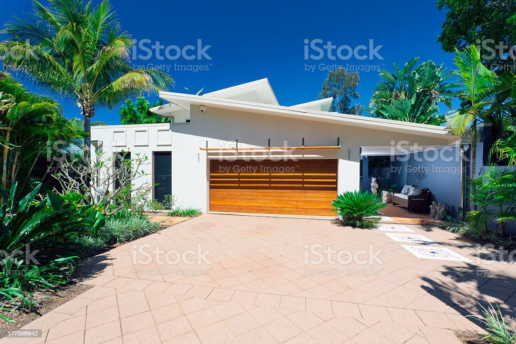 Stylish modern white house front in a sunny day royalty-free stock photo