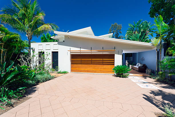 Stylish modern white house front in a sunny day stock photo