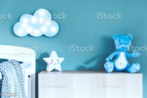 Stylish nursery interior with photo frame teddy bear star and blue picture id979584910?b=1&k=6&m=979584910&s=612x612&h=6xupbebjrhn3gqlfpfmcuhxaiffe6wvdihbyp4nqhu0=