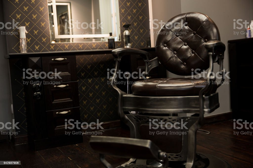 Stylish oldschool chair and cupboard at barber salon stock photo