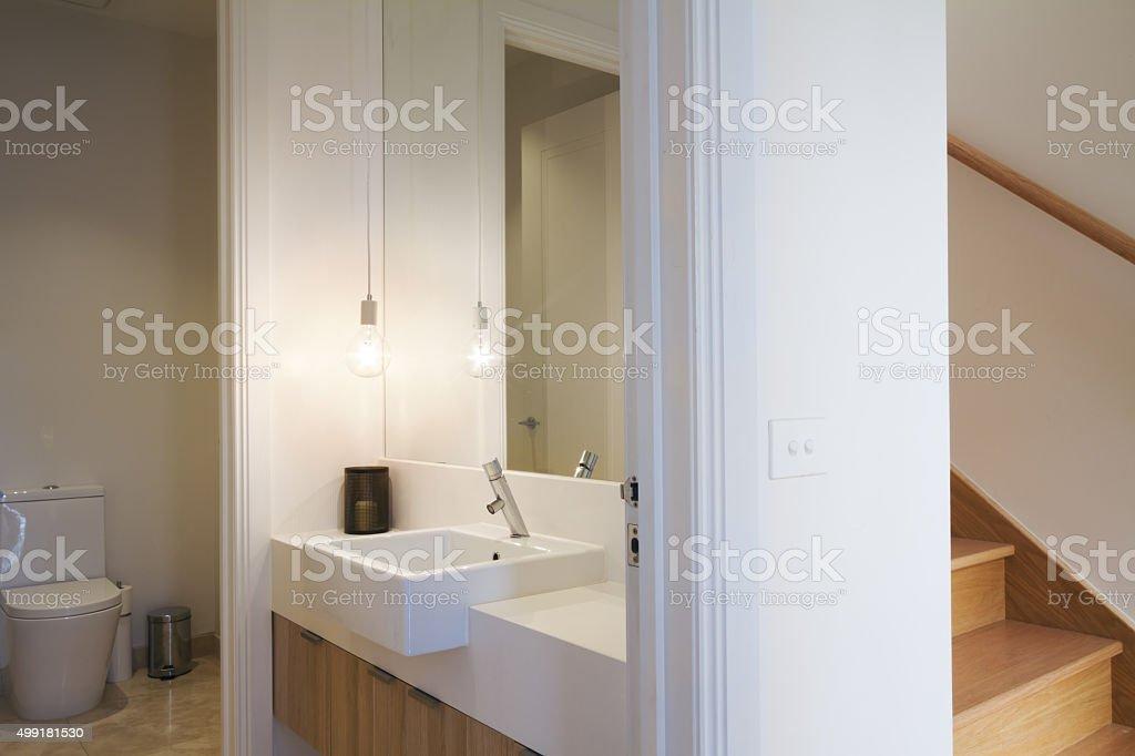 Stylish pendant light in powder room bathroom and Australian lig stock photo