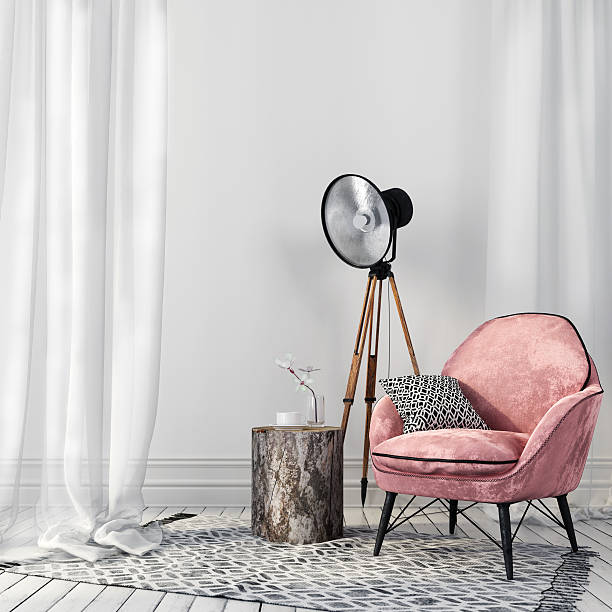 stylish pink chair and a vintage spotlight - retro decor stock photos and pictures