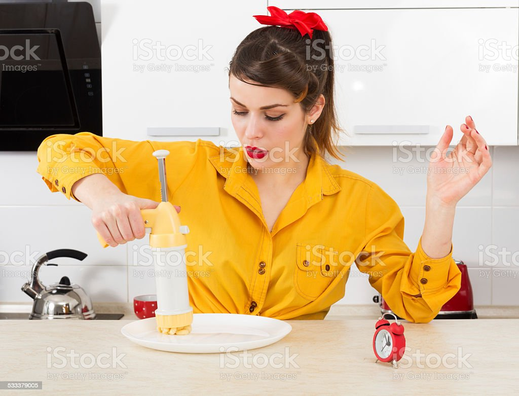 Stylish pin-up housewife stock photo