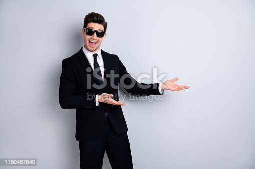 Stylish product concept. Portrait handsome smart real estate agent advise decide give information ad suggest excited content candid enjoy isolated grey background specs eyewear eyeglasses outfit.