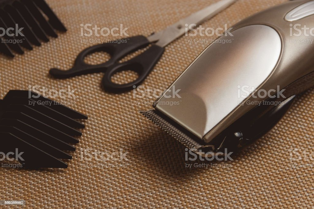 Stylish Professional Hair Clippers, accessories on brown background stock photo