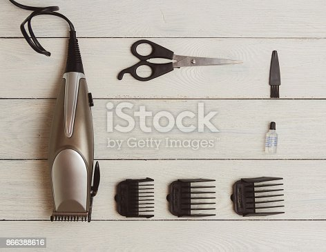 868725110istockphoto Stylish Professional Hair Clippers, accessories on wood background copy space 866388616