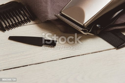 868725110istockphoto Stylish Professional Hair Clippers, accessories on wood background copy space 866388758