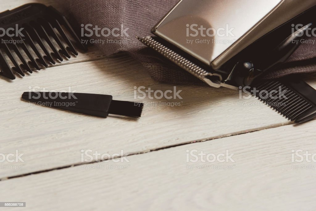 Stylish Professional Hair Clippers, accessories on wood background copy space stock photo