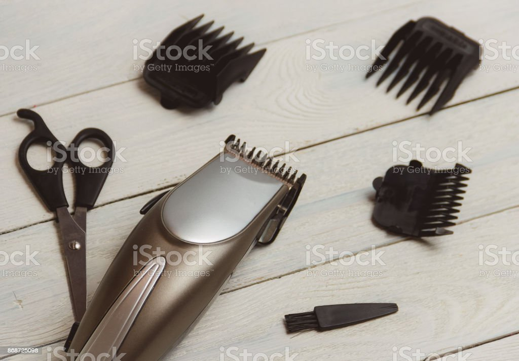 Stylish Professional Hair Clippers, accessories on wood background stock photo