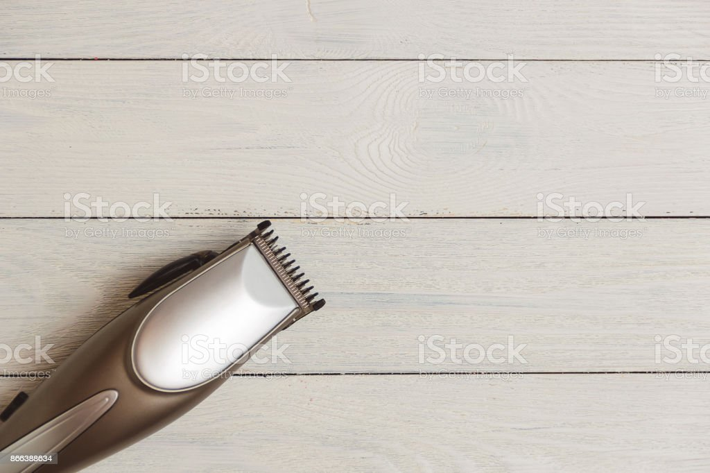 Stylish Professional Hair Clippers on wood background with copy space stock photo