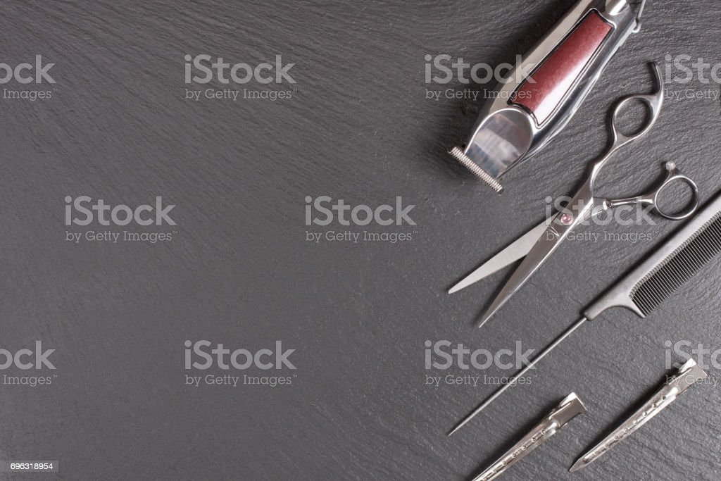 Stylish Professional tool, Hair Cutting on black background. Hairdresser salon concept, Copy space image, top view stock photo
