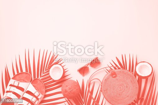 1078252566 istock photo Stylish rattan bag, coconut, birkenstocks, palm branches, sunglasses on coral color background. Top view with copy space. Trendy bamboo bag and white shoes. Summer fashion flat lay 1160037984