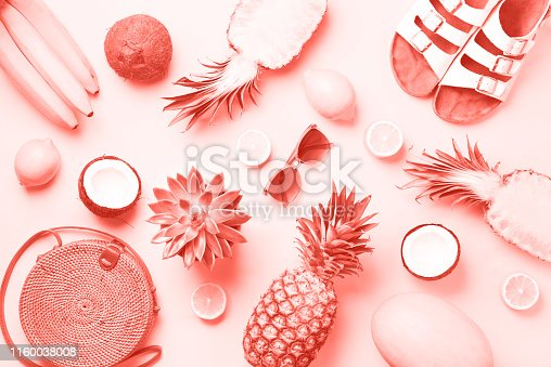 1078252566 istock photo Stylish rattan bag, coconut, birkenstocks, palm branches, sunglasses on coral color background. Top view with copy space. Trendy bamboo bag and white shoes. Summer fashion flat lay 1160038008
