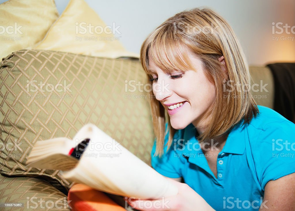 Stylish Real Woman, Reading a Book, Condo Sofa royalty-free stock photo