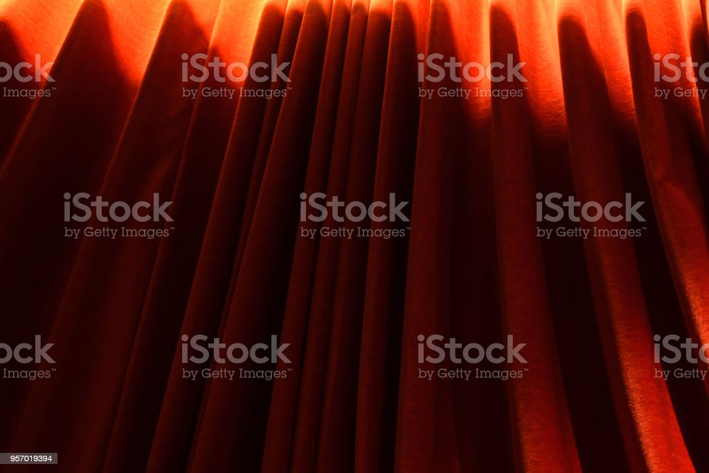 Stylish red curtain clothes of an window stock photo