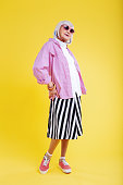 Striped skirt. Stylish retired lady wearing striped white and black skirt and bright pink jacket