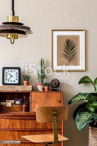 Stylish and vintage interior design of living room with retro furnitures and elegant personal accessories. Mock up poster frame. Template. Home decor.
