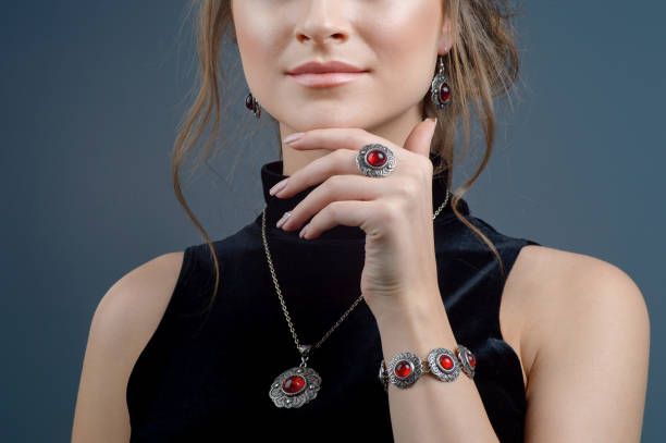 Stylish ring on girl finger. Fashion model beautiful woman demonstrated collection luxury accessory and jewelry stock photo